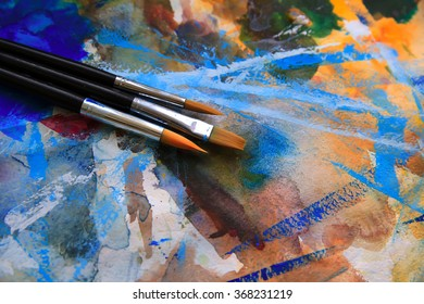 Closeup of brushes and palette.