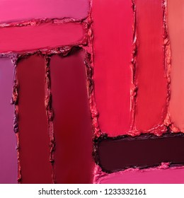 Close-up brushstrokes of different shades of red lipsticks.