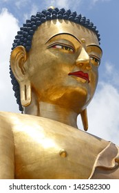 Closeup of Buddha Dordenma Statue against sky is a bronze and gold gilded statue overlooking the city of Thimphu, Bhutan. This 169 feet Giant Buddha is one of the tallest Buddhas in the world.