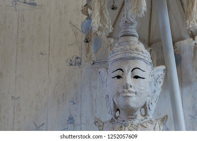 closeup of a buddha statue under a umbrella, Buddhism a spiritual background