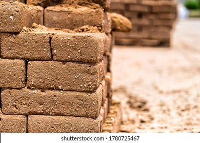 Closeup of building wall of adobe mud sun dried bricks showing texture during construction in New Mexico
