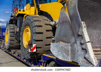 close-up bulldozer on a transport platform. Concept: road construction, heavy construction equipment.