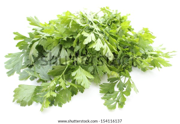 Closeup of bunch of fresh, natural and green parsley isolated on white background