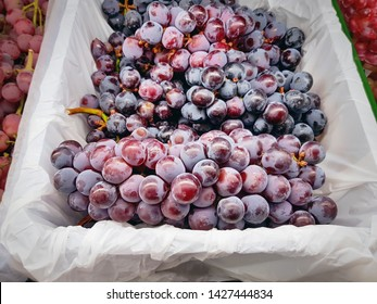 Close-up Bunch of Red Grape Fruits in White Plastic Bag