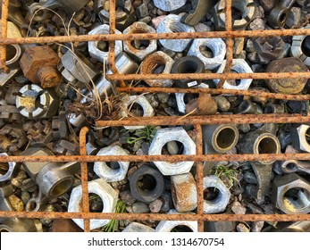 Closeup of a bunch of rusty iron nuts and rebar as background.