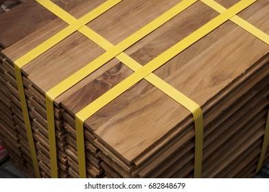Closeup bundle of teak wood parquet for interior floor decoration