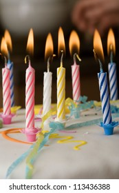 Close-up of burning candles on a birthday cake