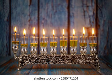 Closeup of a burning Chanukah candlestick with candles Menorah a traditional Jewish holiday