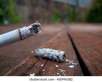 Close-up of Burning Cigarette and Ashes