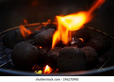 Closeup of burning coals in a barbecue grill