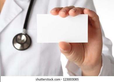 Closeup of business card in doctor's hand