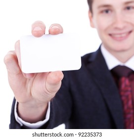 Close-up of business card in business man's hand on white background