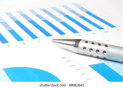 closeup of a business chart with pen
