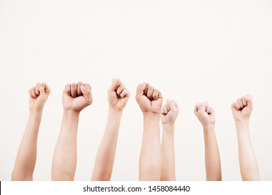 Close-up of business group raising their fists up and demonstrating power isolated on white background