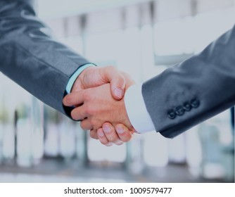 Closeup of a business hand shake between two colleagues.