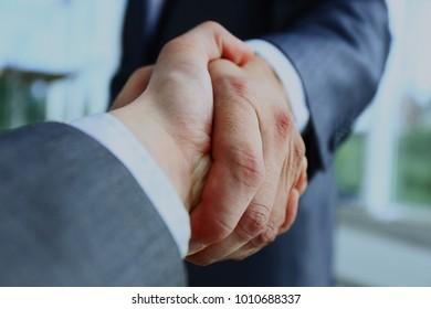 Closeup of a business handshake.