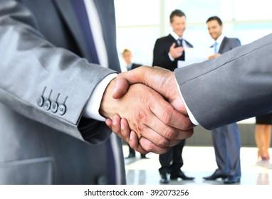 Closeup of a business handshake - Shutterstock ID 392073256