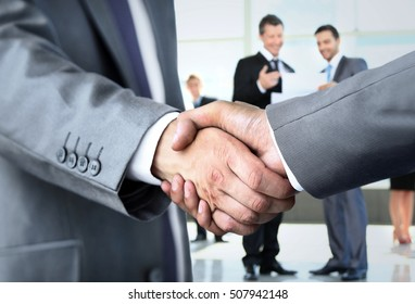 Closeup of a business handshake - Shutterstock ID 507942148