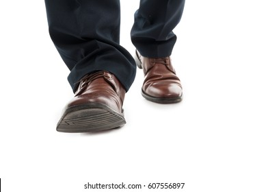 Close-up of business man elegant shoes walking isolated on white background
