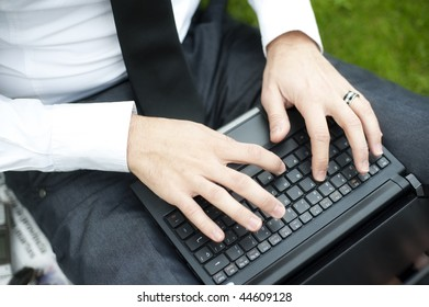 Closeup of business man hands working on laptop.