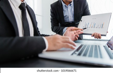 Close-up of business partners looking at business document chart