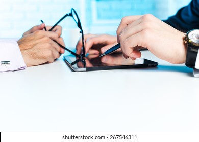 Close-up of business partners looking at business document