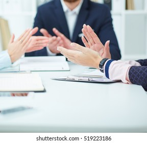 Close-up of business people clapping hands. Business seminar concept.