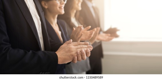 Closeup of business people hands clapping at conference