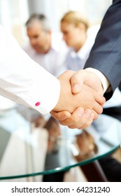 Close-up of business people making agreement in the office