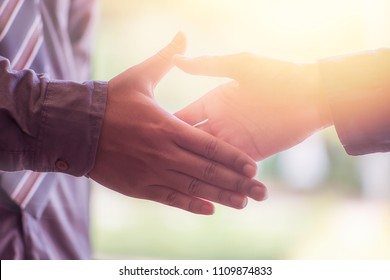 Close-up Business people shaking hands, finishing up meeting. Successful businessman, success, dealing, greeting and partner concept