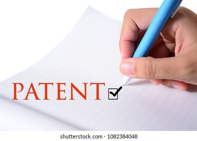 Close-up of business people writing text during business patent