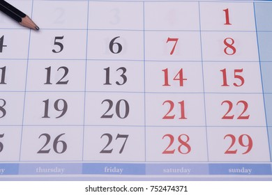 Closeup business quarterly weekly printed black and red numbers