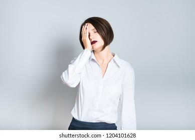 Closeup of business woman forgot about important, short haircut, isolated over a gray background