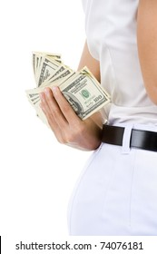 close-up of a business woman hiding money behind her back, isolated on white background