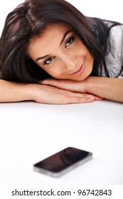Closeup of  business woman waiting for call over white background