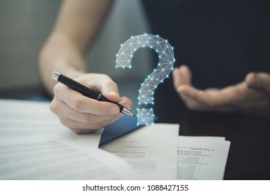Close-up Of Business worker filling questionaire with doubt and need answer