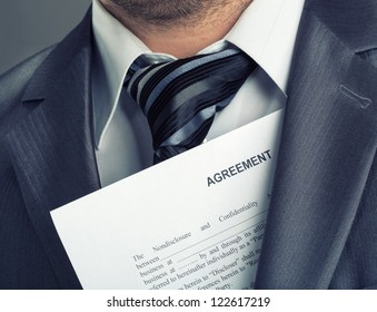 Closeup of businessman with agreement