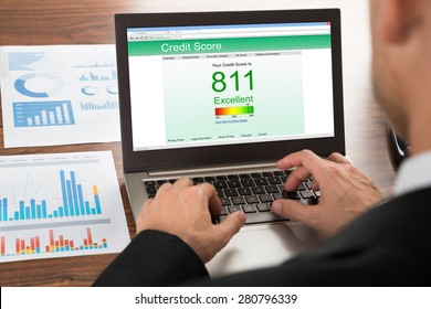 Close-up Of A Businessman Checking Credit Score Online On Laptop