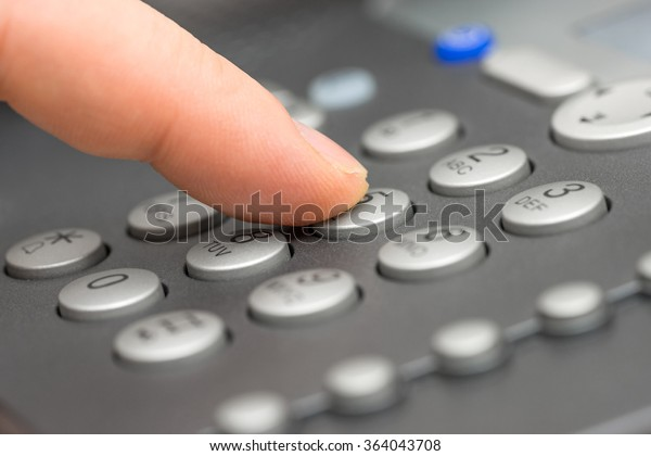 closeup of businessman  Dialing Number On Telephone Keypad