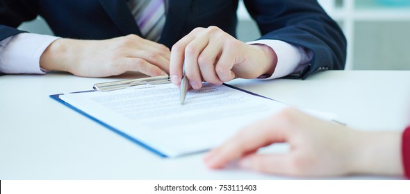 Closeup of businessman explaining  to his new business partner the terms of the agreement or contract. With depth of field image.