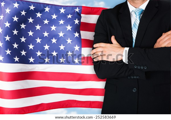 Close-up Of Businessman In Front Of American Flag