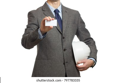 close-up of a businessman in a gray suit with an extended business card