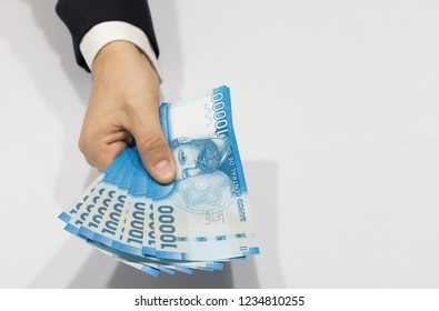 Close-up businessman hand holding chilean money notes. Chile ten thousand (10000) pesos. Selective focus.