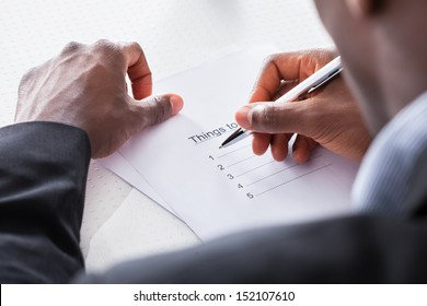 Close-up Of Businessman Hand Planning To Do List