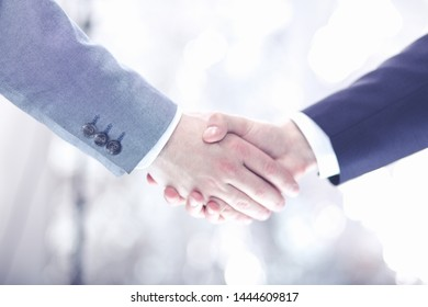 Closeup of a businessman hand shake businesswoman between two colleagues OK, succeed in business