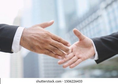 Closeup of a businessman hand shake investor between two colleagues  OK, succeed in business Holding hands. Leave space to write a description of the message.