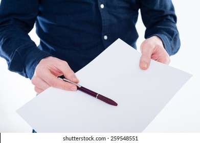 Close-up of businessman handing contract and pen