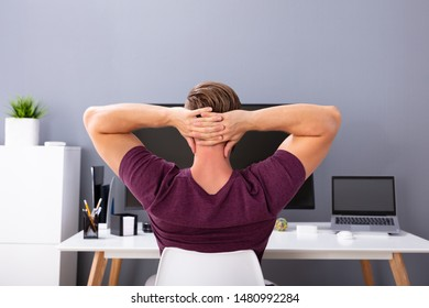 Close-up Of Businessman With Hands Behind Head Relaxing On Chair