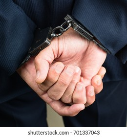 close-up businessman hands in handcuffs. Businessman bribetaker or briber. Concept of fraud, detention, crime and bribery