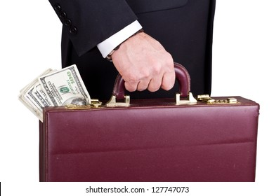 closeup of a businessman holding a briefcase with cash isolated on a white background